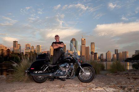 Bike rider with city backround  photo