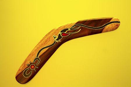 Boomerang on yellow back ground photo