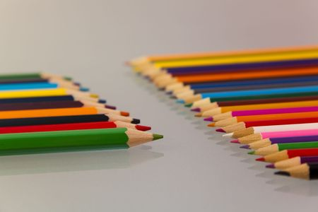 reflective: Colored pencils,  on  reflective background.  Stock Photo