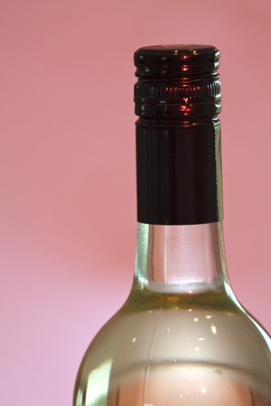 A bottle of white vine with black screw cap