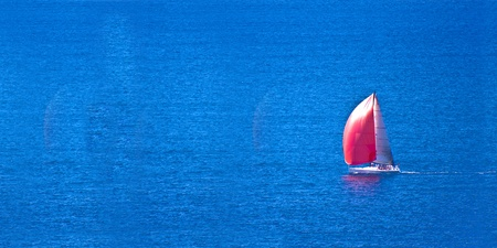 Sail boat with red sail on  blue waters