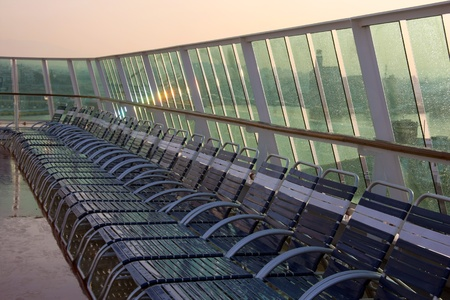 Close view of deck of empty chairs in line  photo