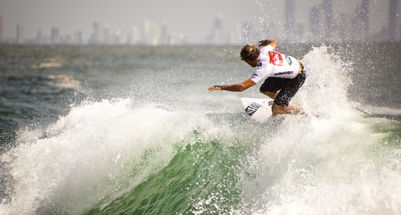 SNAPPER ROCKS, GOLD COAST, AUSTRALIA - FEB 26: Unidentified Surfer races the Quiksilver & Roxy Pro World Title Event. February 26, 2012, Snapper Rocks, Gold Coast, Australia  Stock Photo - 13061887