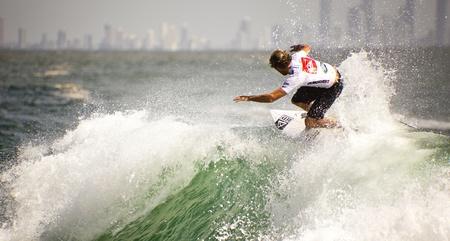 SNAPPER ROCKS, GOLD COAST, AUSTRALIA - 26 FEB: Unidentified Surfer races the Quiksilver & Roxy Pro World Title Event. 26 February 2012, Snapper Rocks, Gold Coast, Australia  Stock Photo - 13061918