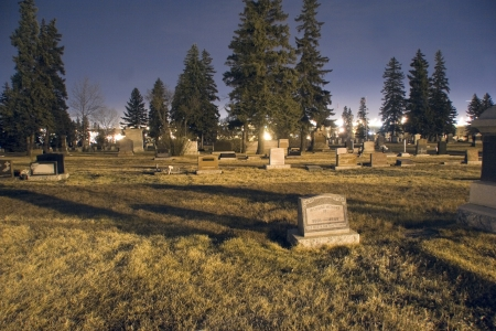 Graveyard  at night photo