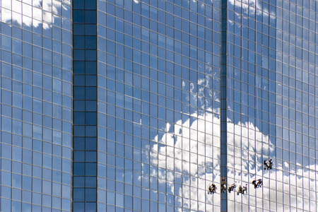 highriser: Professional Window Cleaners on a highriser building Stock Photo