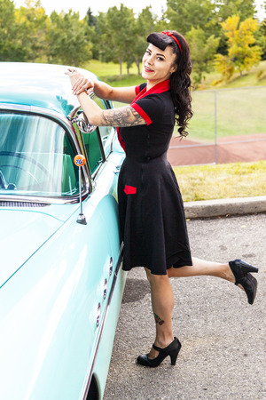 brig: THORNCLIFF CALGARY CANADA, SEPT 13 2014: The annual Show and Shine with Pin Up Girls Cars before 1964  was a great success. Not just great vehicles, models but also  live music brig the 60 Editorial
