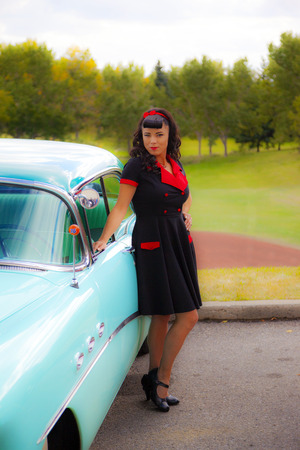 brig: THORNCLIFF CALGARY CANADA, SEPT 13 2014: The annual Show and Shine with Pin Up Girls  Cars before 1964  was a great success. Not just great vehicles, models but also  live music brig the 60