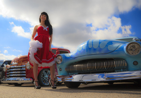 brig: THORNCLIFF CALGARY CANADA, SEPT 13 2014: The annual Show and Shine with Pin Up Girls  Cars before 1964  was a great success. Not just great vehicles, models but also  live music brig the 50