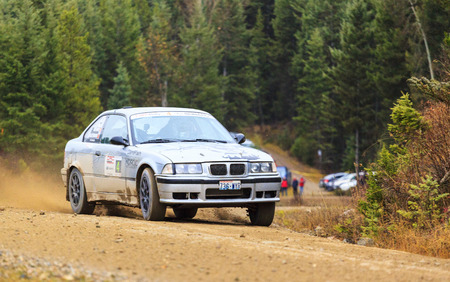 co action: ROCKY MOUNTAIN CANADA - NOV 2 2014:  Canadian Rally Car Championship - the race takes place deep inside the Rocky Mountain  (Day 2) The terrain puts the cars and the drivers to the limit,