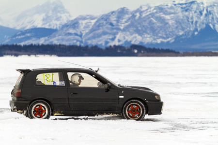 skidding: CALGARY CANADA - JANUARY 18, 2015: The Canadian CSCC Ice Racing on Ghost Lake annual race, where professional and enthusiast drivers were racing over the frozen lake with variety of vehicles.