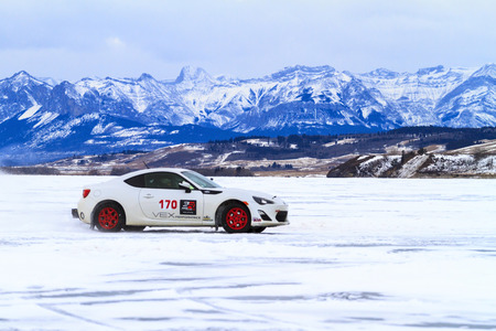 CALGARY CANADA - JANUARY 18, 2015: The Canadian CSCC Ice Racing on Ghost Lake annual race, where professional and enthusiast drivers were racing over the frozen lake with variety of vehicles.