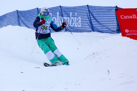 CALGARY CANADA JAN 2 2015. FIS Freestyle Ski World Cup, Winsport, Calgary Unidentified contender practicing on the slope at the Mogul Free Style World Cup on race  day. Imagens - 35935896