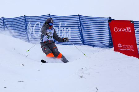 contender: CALGARY CANADA JAN 2 2015. FIS Freestyle Ski World Cup, Winsport, Calgary Unidentified contender practicing on the slope at the Mogul Free Style World Cup on race  day.