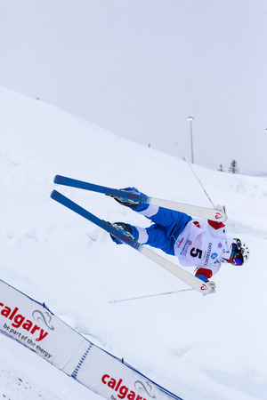 mogul: CALGARY CANADA JAN 2 2015. FIS Freestyle Ski World Cup, Winsport, Calgary Unidentified contender practicing on the slope at the Mogul Free Style World Cup on race  day.