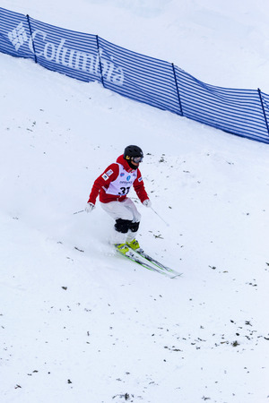 CALGARY CANADA JAN 2 2015. FIS Freestyle Ski World Cup, Winsport, Calgary Unidentified contender practicing on the slope at the Mogul Free Style World Cup on race  day.
