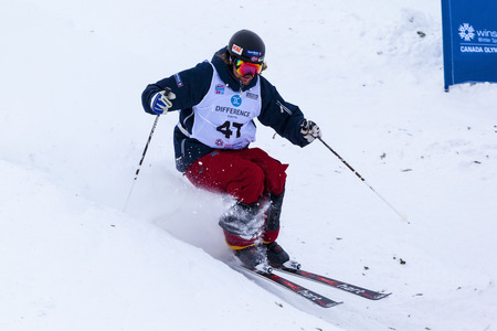 contender: CALGARY CANADA JAN 2 2015. FIS Freestyle Ski World Cup, Winsport, Calgary Unidentified contender practicing on the slope at the Mogul Free Style World Cup on race day. Editorial