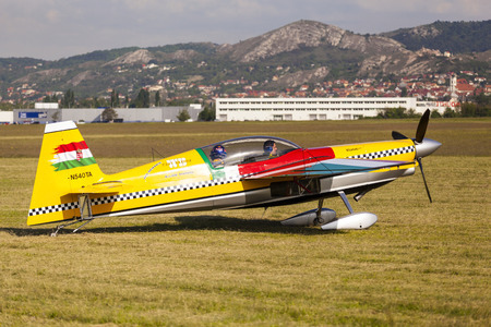 aerobatics: BUDAPEST, HUNGARY - APRIL 30: Aerobatics planes parked at the tarmac at Budaors airport These planes are designed for aerobatic flights.on April 30, 2014 near Budapest, Hungary.