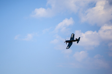 corsair: BUDAPEST, HUNGARY - MAY 1: Corsair historic fighter bomber plane fly-by with Red Bull marking on it\\\\