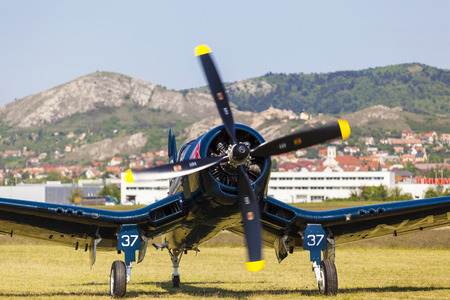 bomber: BUDAPEST, HUNGARY - MAY 1: Corsair historic fighter bomber plane fly-by with Red Bull marking on it Editorial