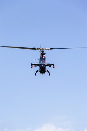 apache: BUDAPEST HUNGARY - MAY 3:An Apache AH-64 demonstrate different flying techniques, for civilian as well as some air force personnel on May 1 2014 Hungary. Editorial