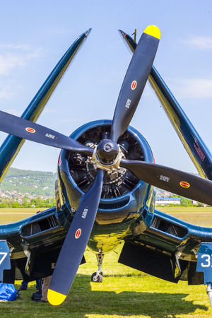 corsair: BUDAPEST, HUNGARY - MAY 1: Corsair historic fighter bomber plane fly-by with Red Bull marking on it Editorial