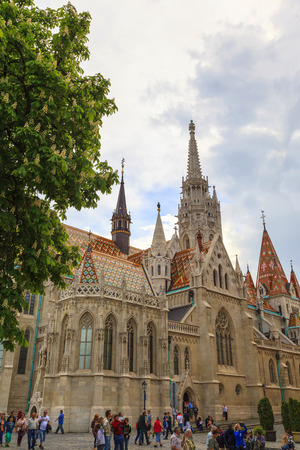 castle district: BUDAPEST - MAY 1: People visit the newly renovated Matthias Church in the Castle District. Matthias Church is one of the most famous landmarks of Budapest and Europe. on May 1, 2014 in Budapest.