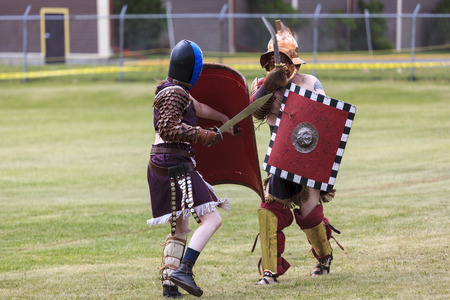 elbow pads: CALGARY CANADA JUN 13 2015: The Military Museum organized Summer Skirmish event where an unidentified soldier is seen in a historical Reenactment Battle. Gladiator fight.
