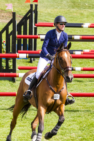CALGARY CANADA - JUN 7 2015: Unidentified rider in action during the prestiges Spruce Meadows International hors jumping competition,  riders comes all over the world to compete. Editöryel