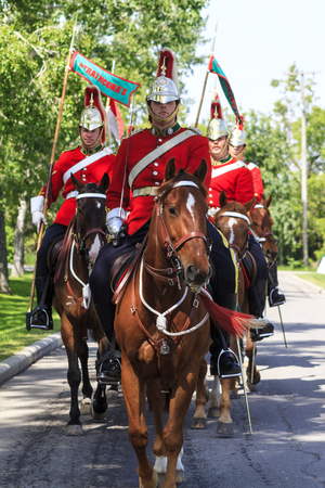 mountie: CALGARY CANADA - JUN 7 2015: The  Lord Strathconas Horse  Royal Canadians Mounted Regiment  parades on Spruce Meadows Show Jumping at the 40th anniversary.