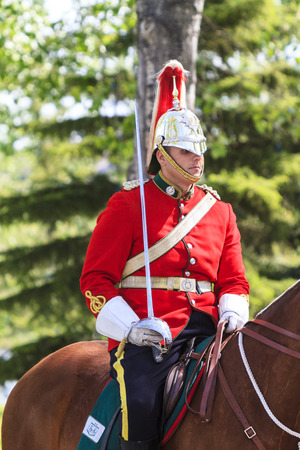 parades: CALGARY CANADA - JUN 7 2015: The  Lord Strathconas Horse  Royal Canadians Mounted Regiment  parades on Spruce Meadows Show Jumping at the 40th anniversary.