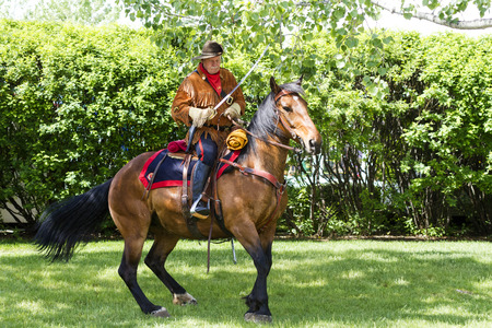 sam: CALGARY CANADA - JUN 7 2015: The Same Steele s Scouts  parades on Spruce Meadows Show Jumping at the 40th anniversary. Sam Steels was one of the best  pioneer scouts in his time. Editorial