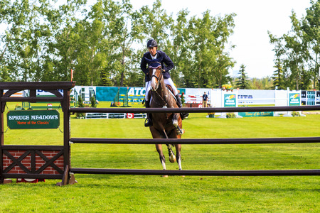 CALGARY CANADA - JUN 7 2015: Unidentified rider in action during the prestige's Spruce Meadows International hors jumping competition,  riders comes all over the world to compete. 에디토리얼