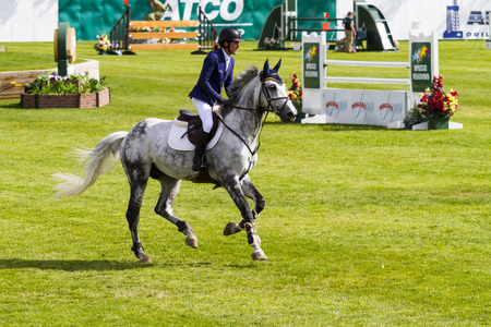 CALGARY CANADA - JUN 7 2015: Unidentified rider in action during the prestiges Spruce Meadows International hors jumping competition,  riders comes all over the world to compete. Editorial