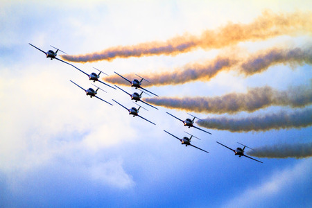 canadian military: SPRINGBANK  CANADA - JUN 20, 2015: The Snowbirds Demonstration Team demonstrate the skill, professionalism, and teamwork of Canadian Forces personnel during the Wings Over Springbank.