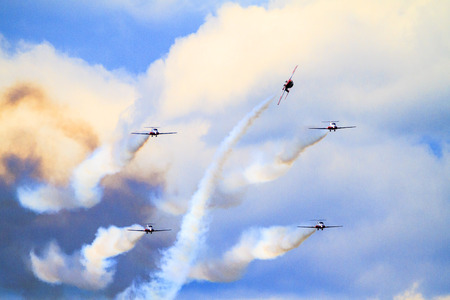 professionalism: SPRINGBANK  CANADA - JUN 20, 2015: The Snowbirds Demonstration Team demonstrate the skill, professionalism, and teamwork of Canadian Forces personnel during the Wings Over Springbank.