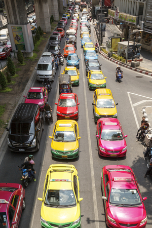 congested: BANGKOK APRIL 27: Traffic moves slowly along a busy road in Sathorn district on April 27 2014 in Thailand. Annually an estimated 150,000 new cars join the heavily congested roads of Bangkok.