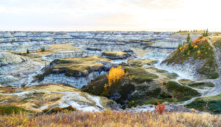 mesas: Badlands landscape, formed by deposition and erosion by wind and water, contains some of the richest fossil beds in the world,
