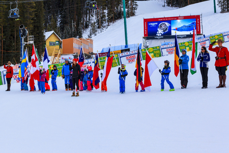 snow man party: LAKE LOUISE ALBERTA CANADA - DECEMBER 7. 2015: The R.C,M,P and representatives of competitors and organizers during the opening ceremony of the Alpine Ski Ladies Super G event.