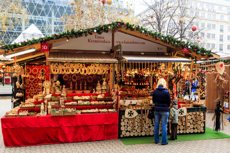 BUDAPEST, HUNGARY - DEC 19 2015: Tourists enjoy the Christmas market in the city center on in Budapest, Hungary. This traditional Christmas fair attracts 700,000 visitors each year.