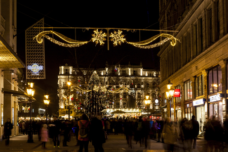 christmas spirit: BUDAPEST, HUNGARY - DEC 19 2015: Tourists enjoy the Christmas spirit and the light show in down town Budapest. This traditional Christmas fair attracts over million visitors each year.