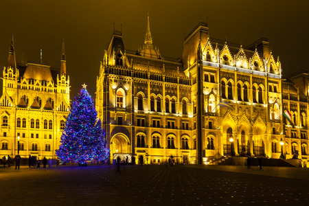 Tourists enjoy the Christmas lights at the Parliament House in Budapest, Hungary. This traditional Christmas fair attracts abut 700,000 visitors each year.