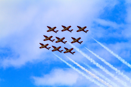 air demonstration: LETHBRIDGE CANADA - JUN 25, 2015: The Snowbirds Demonstration Team demonstrate the skill, professionalism, and teamwork of Canadian Forces personnel during the Wings Over Lethbridge.