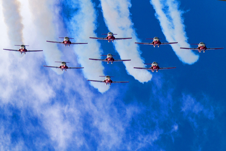 canadian military: LETHBRIDGE CANADA - JUN 25, 2015: The Snowbirds Demonstration Team demonstrate the skill, professionalism, and teamwork of Canadian Forces personnel during the Wings Over Lethbridge.
