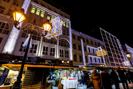 down town: BUDAPEST, HUNGARY - DEC 19 2015: Tourists enjoy the Christmas spirit and the light show in down town Budapest. This traditional Christmas fair attracts over million visitors each year.