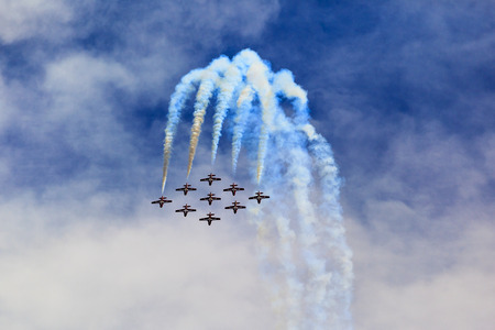 force: LETHBRIDGE CANADA - JUN 25, 2015: The Snowbirds Demonstration Team demonstrate the skill, professionalism, and teamwork of Canadian Forces personnel during the Wings Over Lethbridge.