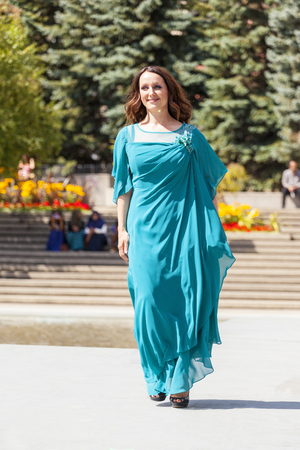 bailarinas arabes: CALGARY CANADA- JULY 10, 2014: Models walk runway at The Calgary Arab Festival in Olympic Plaza  The festival celebrates the depth and diversity of cultures across Arabic countries.   This  festival was the first year and organizers hope to make it an ann Editorial