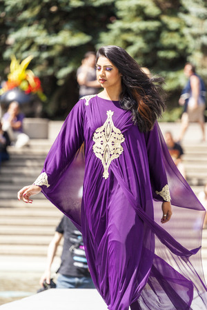 libertine: CALGARY CANADA- JULY 10, 2014: Models walk runway at The Calgary Arab Festival in Olympic Plaza  The festival celebrates the depth and diversity of cultures across Arabic countries.   This  festival was the first year and organizers hope to make it an ann Editorial