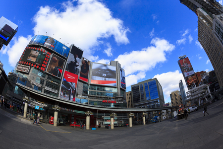 hosts: TORONTO,CANADA - FEB 5 2016: Yonge-Dundas Square in Toronto, Canada. Yonge- Dunda Square is a commercial, and public square, hosts many events, and one of Torontos main attraction.