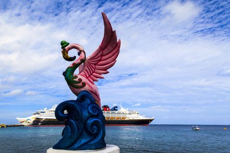 cozumel: COZUMEL, MEXICO - JAN 26 2016: Statues on the sea shore promenade. View from Cozumel island, the most popular destination in Caribbean (Mexico). The economy of Cozumel is based on tourism.
